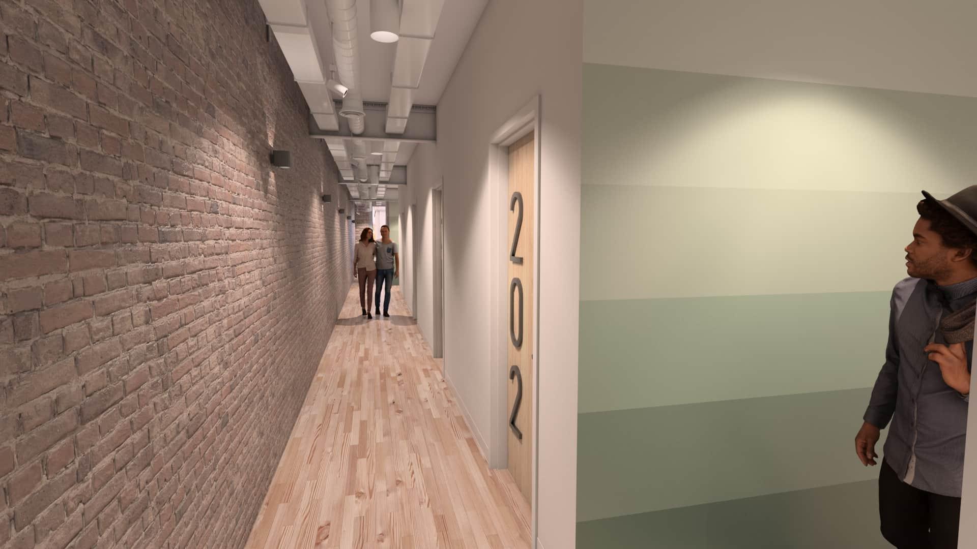 Photo looking down SOVA hallway with people walking