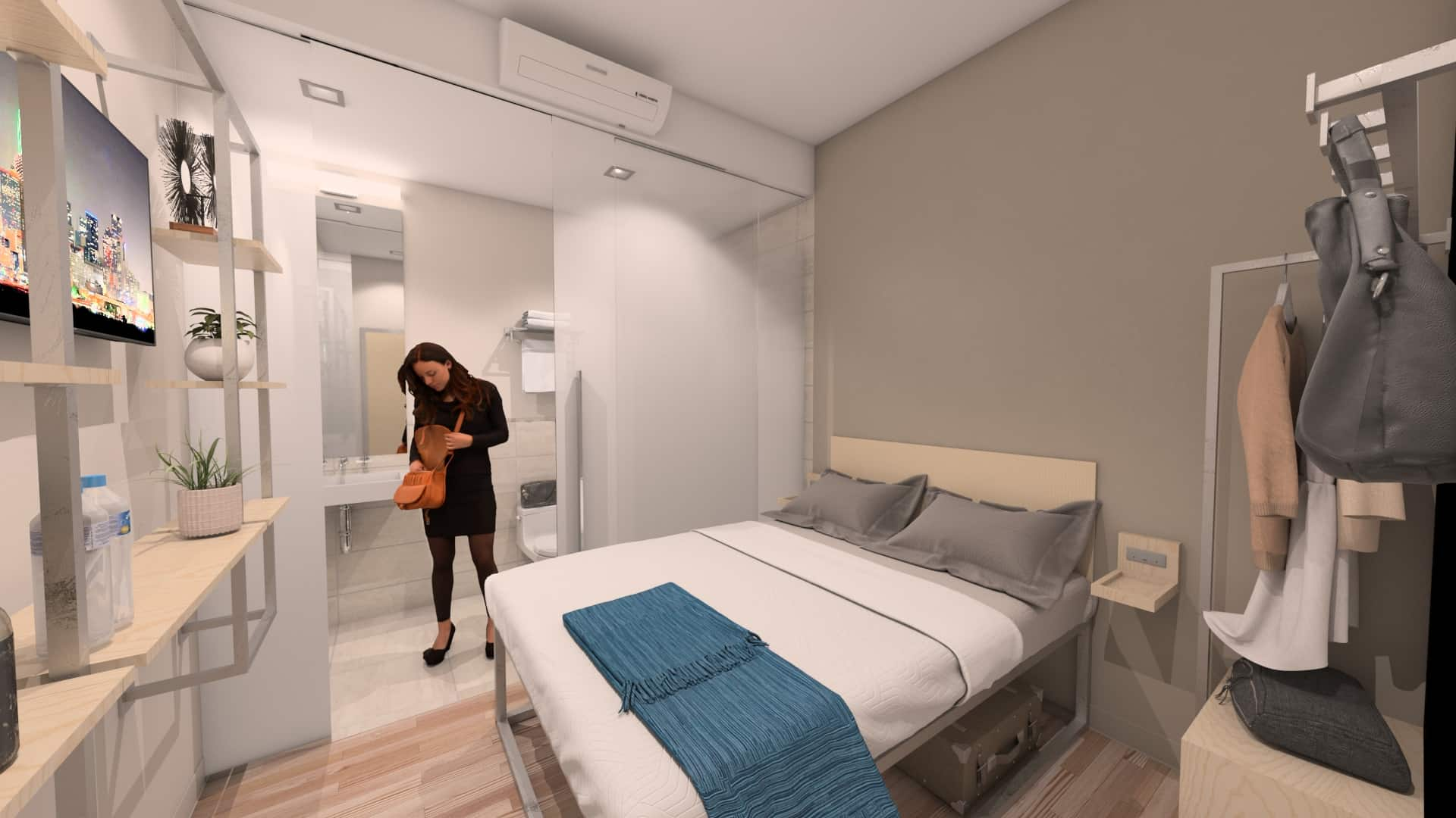 Photo showing interior of a bedroom, with bed and bathroom areas.